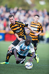 Alloa Athletic's Stephen Simmons and Hearts Morgaro Gomis.<br /> half time : Alloa Athletic 0 v 0 Hearts, Scottish Championship played at Recreation Park, Alloa.