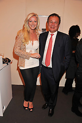MICHELLE MONE and ROB TEMPLEMAN at the Graduate Fashion Week Gala drinks reception held at Earls Court 2, London on 13th June 2012.