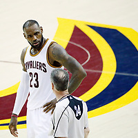 09 June 2017: Cleveland Cavaliers forward LeBron James (23) talks to referee Mike Callahan (24) during the Cleveland Cavaliers 137-11 victory over the Golden State Warriors, in game 4 of the 2017 NBA Finals, at  the Quicken Loans Arena, Cleveland, Ohio, USA.