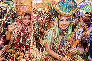 28 JUNE 2014 - DAN SAI, LOEI, THAILAND: Girls march in the Ghost Festival parade in Dan Sai. Phi Ta Khon (also spelled Pee Ta Khon) is the Ghost Festival. Over three days, the town's residents invite protection from Phra U-pakut, the spirit that lives in the Mun River, which runs through Dan Sai. People in the town and surrounding villages wear costumes made of patchwork and ornate masks and are thought be ghosts who were awoken from the dead when Vessantra Jataka (one of the Buddhas) came out of the forest.    PHOTO BY JACK KURTZ