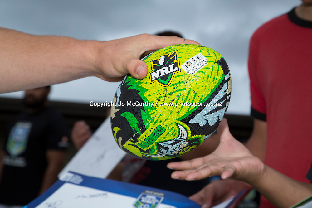 Canberra Raiders ball gets returned after being autographed. NRL Nines Community Club Visit - Canberra Raiders at Bay Roskill Vikings, Blockhouse Bay Reserve, Auckland, New Zealand. Thursday 13 February 2014. Photo: Jo McCarthy / www.photosport.co.nz