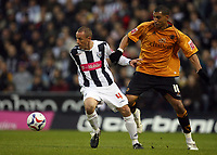 Photo: Rich Eaton.<br /> <br /> West Bromwich Albion v Wolverhampton Wanderers. Coca Cola Championship. Play off Semi Final 2nd Leg. 16/05/2007. West Broms Chris Perry left holds off Wolves Jay Bothroyd