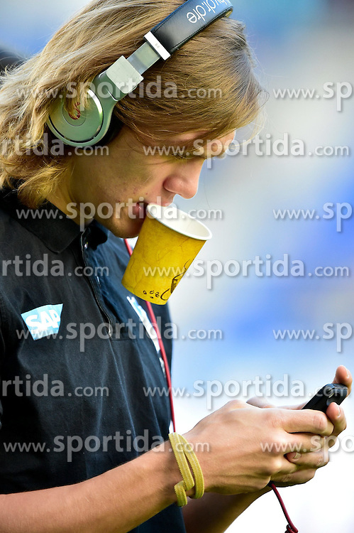 08.11.2014, Rhein Neckar Arena, Sinsheim, GER, 1. FBL, TSG 1899 Hoffenheim vs 1. FC K&ouml;ln, 11. Runde, im Bild Portrait Portraet Jannik Vestergaard TSG 1899 Hoffenheim mit Kopfhoerer Smartphone Handy und unkonventioneller Haltung des kaffee Kaffeebecher im Mund // during the German Bundesliga 11th round match between TSG 1899 Hoffenheim and 1. FC Cologne at the Rhein Neckar Arena in Sinsheim, Germany on 2014/11/08. EXPA Pictures &copy; 2014, PhotoCredit: EXPA/ Eibner-Pressefoto/ Weber<br /> <br /> *****ATTENTION - OUT of GER*****