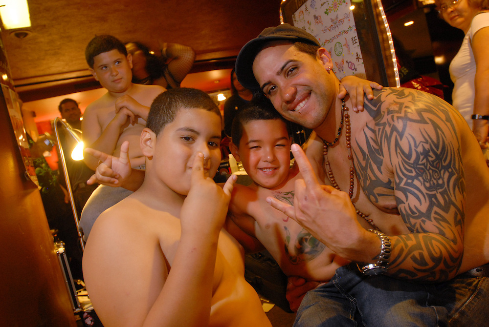 New York City Tattoo Convention 2009 at the Roseland Ballroom: Norman Lopez (right) with John Miranda, 9, and Jordan Lopez, 6, (center) got temporary tattoos from Raquel's Tattoos and kids favorite.