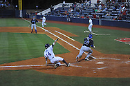 Ole MIss' Cameron Dishon (14) scores vs. Kentucky's Greg Fettes (4) at Oxford-University Stadium in Oxford, Miss. on Thursday, April 25, 2013. Kentucky won 3-2.