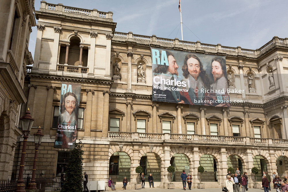 Exterior of the Royal Academy in Piccadilly where the exhibition entitled 'Charles 1, King and Collector' is exhibited, on 6th April 2018, in London, England. This is a new cast of the original that was first exhibited outside the RA in 1904 and is an allegory of the human need for new challenges, of our instinct to always be scanning the horizon and the future. King Charles I amassed one of the most extraordinary art collections of his age, acquiring works by some of the finest artists of the past – Titian, Mantegna, Holbein, Dürer – and commissioning leading contemporary artists such as Van Dyck and Rubens. Following the his execution in 1649, the king's collection was sold off and scattered across Europe. Many works were retrieved during the Restoration, others now form the core of museums such as the Louvre and the Prado. This show reunites the greatest masterpieces of this magnificent collection for the first time.