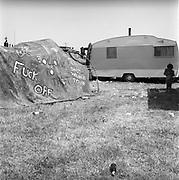 'Fuck off' sign near caravan, at Glastonbury, 1989.