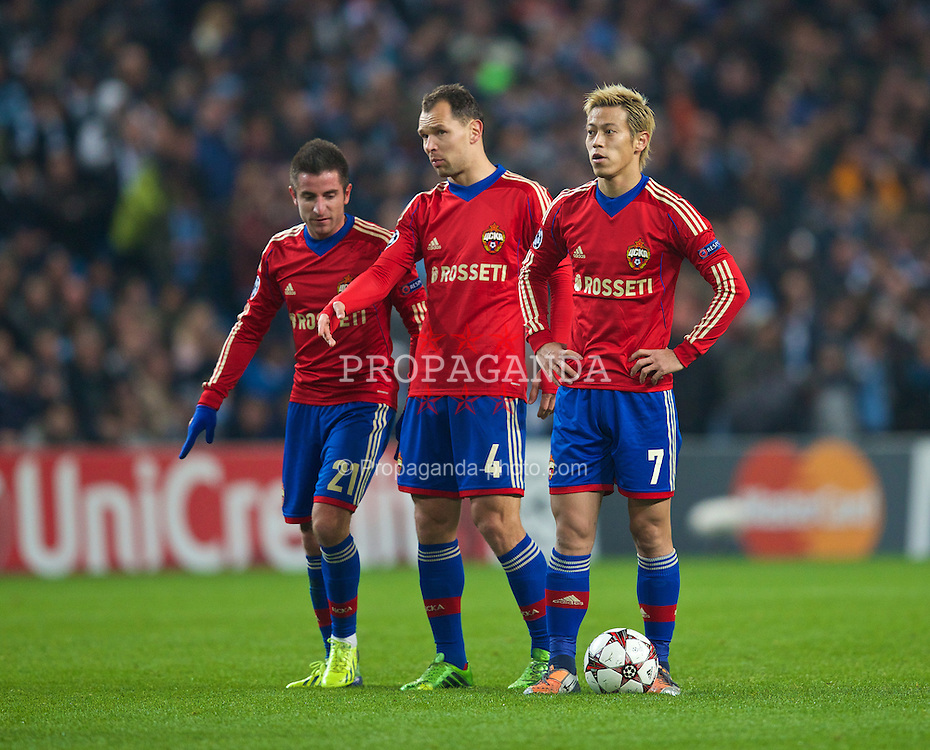 MANCHESTER, ENGLAND - Tuesday, November 5, 2013: CSKA Moscow's Zoran Tosic, Sergei Ignashevich and Keisuke Honda during the UEFA Champions League Group D match at the City of Manchester Stadium. (Pic by David Rawcliffe/Propaganda)