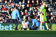 Tottenham Hotspur midfielder Mousa Dembele receives treatment after scoring during the Barclays Premier League match between Bournemouth and Tottenham Hotspur at the Goldsands Stadium, Bournemouth, England on 25 October 2015. Photo by Mark Davies.