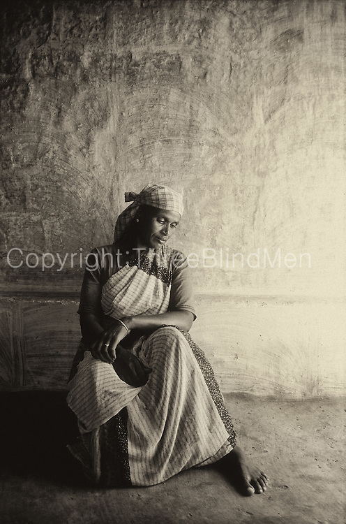 Sri Lanka. Woman in her home at Bowlana. near Deltota.