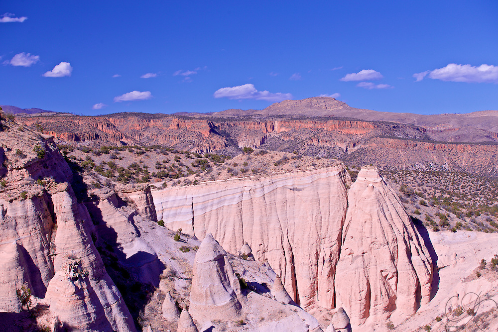 Red, Whites and Blues of the New Mexico landscape: The White cliffs of Kasha-Katuwe, the Red cliffs of the southwest underneath the blue skies of spring.