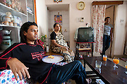Shashi Kanth, a call center worker, eats breakfast at his home in Bangalore, India. (Shashi Kanth is featured in the book What I Eat: Around the World in 80 Diets.)  The caloric value of his typical day's worth of food on a day in December was 3000 kcals. He is 23 years of age; 5 feet, 7 inches; and 123 pounds. MODEL RELEASED.
