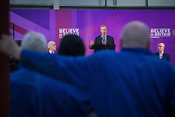 © Licensed to London News Pictures . 23/03/2015 . Middleton , UK . Nigel Farage speaks as John Bickley and Paul Nuttall listen . UKIP leader Nigel Farage , Deputy Leader Paul Nuttall and Economics Spokesman Patrick O'Flynn announce UKIP's economic policy at Concept Metal Products and Co Ltd in Middleton , Lancashire . Photo credit : Joel Goodman/LNP