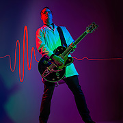 UVU student Brian Patchett who is doing research on sound waves and cancer and is also a musician for the cover story of the Alumni Spring Magazine in the studio on the campus of Utah Valley University in Orem , Utah, Tuesday, Feb. 23, 2016. (August Miller, UVU Marketing)
