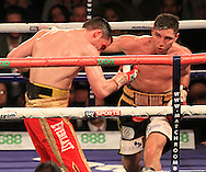 Picture by Richard Gould/Focus Images Ltd +44 7855 403186<br /> 02/11/2013<br /> Coyle (black &amp; Gold) delivers the knock out punch to Simpson (Red) at Hull Ice Arena, Hull.