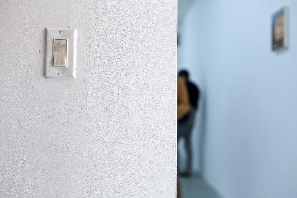 smudgy light switch in an art gallery