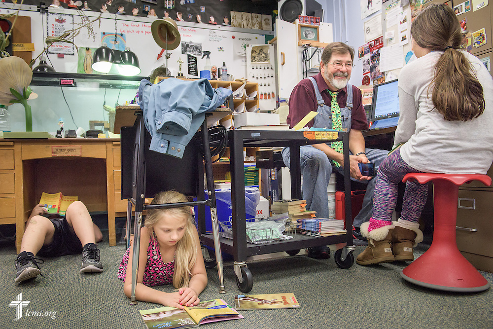 4th grade teacher Craig Schaubs tests a student on her reading progress while other students find quiet spaces of their own during reading time in the classroom on Thursday, Oct. 27, 2016, at First Immanuel Lutheran School in Cedarburg, Wis. LCMS Communications/Erik M. Lunsford