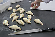 Preparing Croissants at a bakery made from puff pastry
