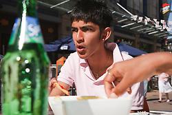 Teenage boy at cafe.