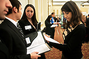 Hala Annabi (right) looks over Mark Harrison's resume during the spring Career and Internship Fair. Also pictured are Danielle Feldman (center) and Teddy Franz (far left). Photo by: Ross Brinkerhoff.
