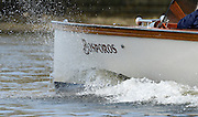 London, United Kingdom.  Saturday Morning,  Oxford launch, Bosporos cut's through the water as she follows the Oxford Blue Boat training outing.  2014, Varsity, Tideway Week, annual training week, both crews based at Putney, Championship Course,  River Thames;   10:46:36 - Saturday  - 05/04/2014  [Mandatory Credit; Peter SPURRIER/Intersport Images].