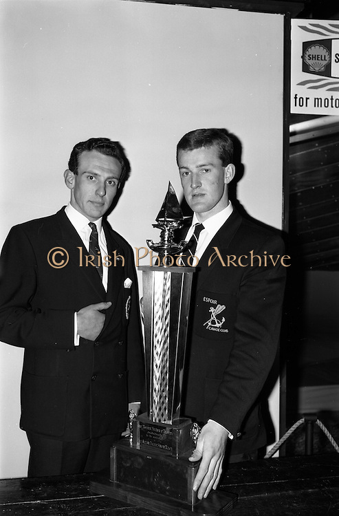 14/03/1964<br /> 03/14/1964<br /> 14 March 1964<br /> Presentations at the conclusion of the Third Irish Boat Show at the R.D.S., Ballsbridge, Dublin. Mr Derek Martin (left) Honoray Secretary of the Irish Canoe Union and Mr Frank Crawley, Espoir Canoe Club, Mount Merrion, Dublin, with the Noyek Seaply trophy after the presentation.