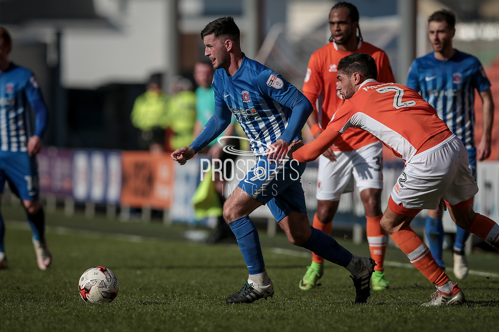 Pádraig Amond (Hartlepool United) and Kelvin Mellor (Blackpool) during the EFL Sky Bet League 2 match between Blackpool and Hartlepool United at Bloomfield Road, Blackpool, England on 25 March 2017. Photo by Mark P Doherty.