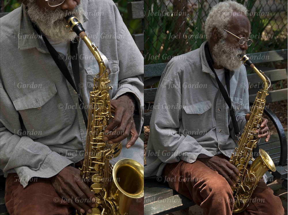 77 year old jazz musician, Giuseppi Logan, sitting on bench in Tompkins Square Park playing jazz on his saxophone.<br />