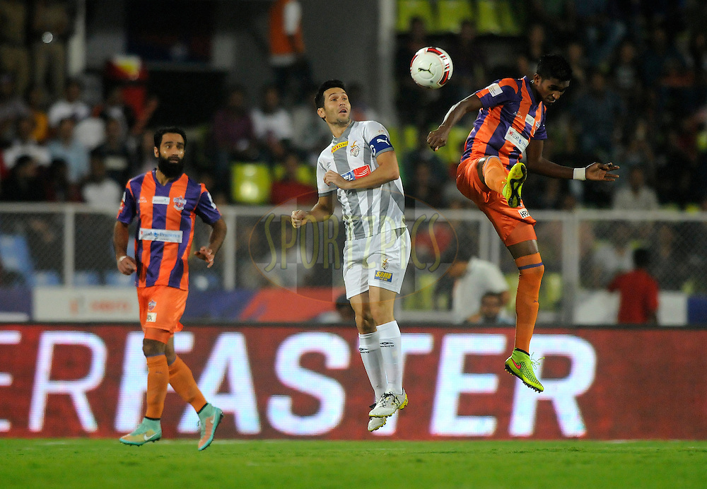 Luis Javier Garcia Sanz of Atletico de Kolkata and Lenny Rodrigues of FC Pune City take a header during match 44 of the Hero Indian Super League between FC Pune City and Atletico de Kolkata FC held at the Shree Shiv Chhatrapati Sports Complex Stadium, Pune, India on the 29th November 2014.<br /> <br /> Photo by:  Pal Pillai/ ISL/ SPORTZPICS