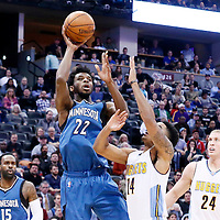 15 February 2017: Minnesota Timberwolves forward Andrew Wiggins (22) goes for the jump shot over Denver Nuggets guard Gary Harris (14) during the Minnesota Timberwolves 112-99 victory over the Denver Nuggets, at the Pepsi Center, Denver, Colorado, USA.