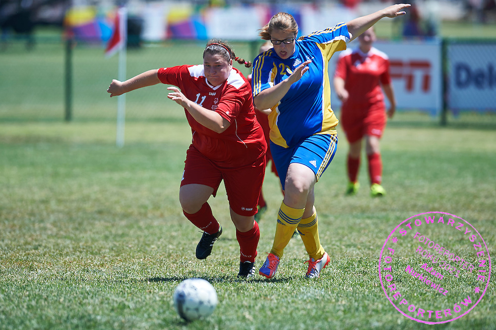SO Poland athlete (L) fights for the ball with SO Sweden athlete (R) while football women match 7-a-side during fourth day of the Special Olympics World Games Los Angeles 2015 on July 28, 2015 at Balboa Sports Centre in Los Angeles, USA.<br /> USA, Los Angeles, July 28, 2015<br /> <br /> Picture also available in RAW (NEF) or TIFF format on special request.<br /> <br /> For editorial use only. Any commercial or promotional use requires permission.<br /> <br /> Adam Nurkiewicz declares that he has no rights to the image of people at the photographs of his authorship.<br /> <br /> Mandatory credit:<br /> Photo by &copy; Adam Nurkiewicz / Mediasport