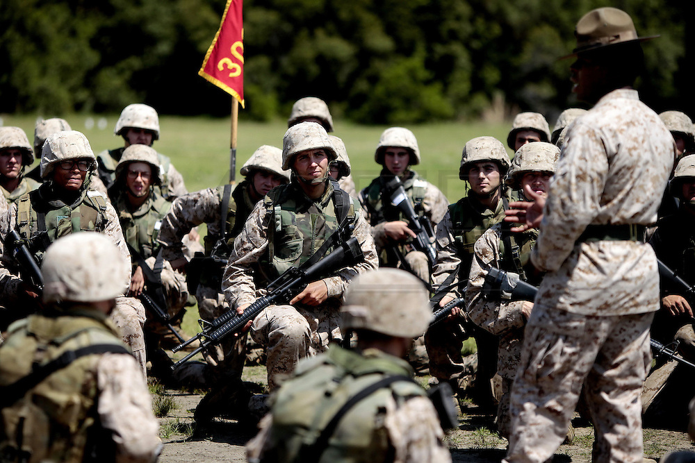 Recruits listen to instruction from their drill instructor as they prepare to leave the rifle range.  Marine Corps Recruit Depot at Parris Island in South Carolina is where all male recruits living east of the Mississippi River and all female recruits from all over the US receive their arduous twelve week training in their quest to become marines. Even though there are two current active wars and a weak economy, recruitment has not been effected.  Actually, recruiting numbers have increased, with more young men and women looking toward the military for answers.