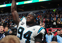 American Football - 2019 NFL Season (NFL International Series, London Games) - Tampa Bay Buccaneers vs. Carolina Panthers<br /> <br /> British born, Efe Obada at the final whistle, salutes the crowd at Tottenham Hotspur Stadium.<br /> Efe Obada played just 5 games of Amateur American Football for the London Warriors, has made it to the elite level with the Panthers and is now a regular starter.<br /> <br /> COLORSPORT/ANDREW COWIE