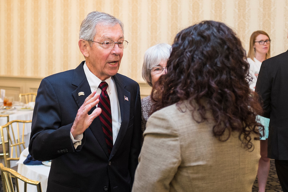 Former Senator George Voinovich chats with an attendee after the 32nd Annual Ohio University State Government Alumni Luncheon on Tuesday, May 5, 2015.  Photo by Ohio University  /  Rob Hardin