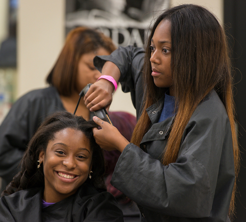 Cosmetology students prepare for the Hair Battle Royale at Barbara Jordan High School, January 13, 2014.