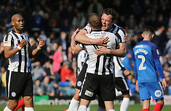 Harrison McGahey of Rochdale embraces with team-mate Matt Done to celebrate victory at full-time - Mandatory by-line: Joe Dent/JMP - 14/04/2018 - FOOTBALL - ABAX Stadium - Peterborough, England - Peterborough United v Rochdale - Sky Bet League One