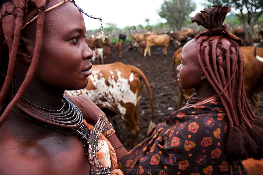 Viahondjera Musutua, a Himba woman (at left), stands in a corral filled with cows in the small village of Ondjete in northwestern Namibia. (Viahondjera Musutua is featured in the book What I Eat: Around the World in 80 Diets.)