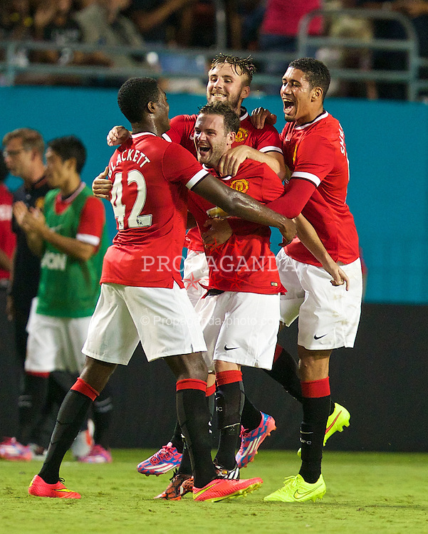 MIAMI, USA - Monday, August 4, 2014: Manchester United's Juan Mata celebrates scoring the second goal against Liverpool during the International Champions Cup Final match at the SunLife Stadium on day fifteen of the club's USA Tour. (Pic by David Rawcliffe/Propaganda)