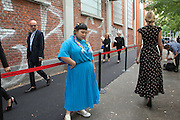 Naomi, Japanese fashion fan, poses waiting for the entrance to Fendi fashion show during the annual Milan Fashion Week, Milan September 22, 2016.