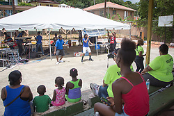 Residents enjoy the Avengerz Band.  First annual Savan Resource Fair & Re-dedication Ceremny at Savan Basketball Court.  25 July 2015.  © Aisha-Zakiya Boyd