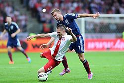 14.10.2014, Nationalstadium, Warsaw, POL, UEFA Euro Qualifikation, Polen vs Schottland, Gruppe D, im Bild ARTUR JEDRZEJCZYK (L), JAMES MORRISON (P) // during the UEFA EURO 2016 Qualifier group D match between Poland and Scotland at the Nationalstadium in Warsaw, Poland on 2014/10/14. EXPA Pictures © 2014, PhotoCredit: EXPA/ Newspix/ Michal Stanczyk<br /> <br /> *****ATTENTION - for AUT, SLO, CRO, SRB, BIH, MAZ, TUR, SUI, SWE only*****