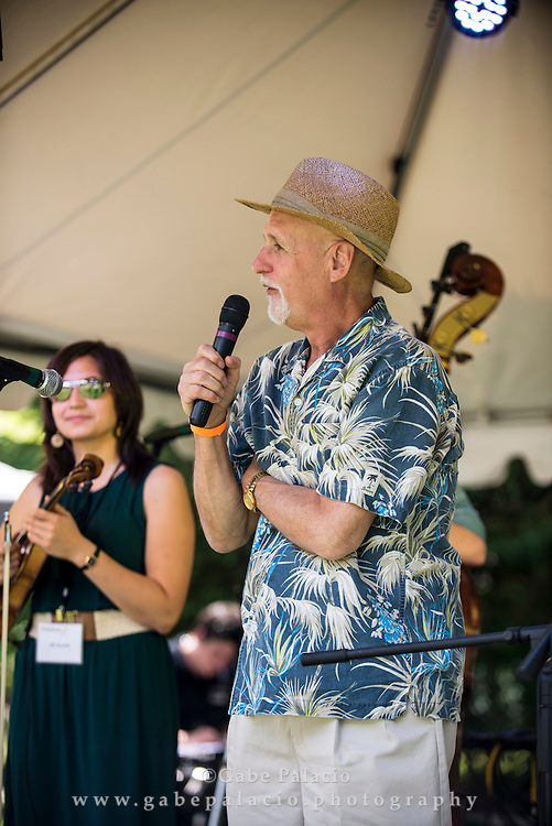 John Platt, WFUV host of the Sunday Breakfast show and the festival Master of Ceremonies, makes introductions at  the Friends Field set at the American Roots Music Festival at Caramoor in Katonah New York on June 28, 2014. <br /> (photo by Gabe Palacio)