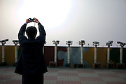 Dorasan/South Korea, Republic Korea, KOR, 28.11.2009: Tourists at the Dorasan Observatory tries to get an image of the DMZ and North Korea but he is not allowed to get closer because of prohibited photography at a closer range. From the observation platform, North Korean military personnel are visible, and so are the highlights of Gaeseong and the Geumgangsan Diamond Mountains.