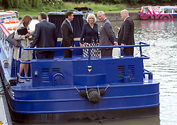 The Prince of Wales and  Duchess of Cornwall during a tour of the Olympic Park waterways  in London , Wednesday 13th June 2012.  Photo by: i-Images
