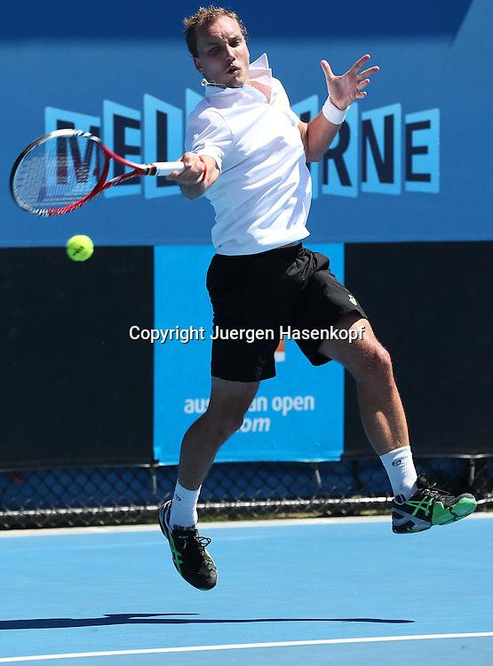 Australian Open 2013, Melbourne Park,ITF Grand Slam Tennis Tournament,.Steve Darcis (BEL),Aktion,Einzelbild,Ganzkoerper,Hochformat, .