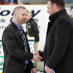 TRENTON, ON  - MAY 5,  2017: Canadian Junior Hockey League, Central Canadian Jr. &quot;A&quot; Championship. The Dudley Hewitt Cup. Game 7 between The Georgetown Raiders and The Powassan Voodoos. Coaches shake hands after the game <br /> (Photo by Amy Deroche / OJHL Images)