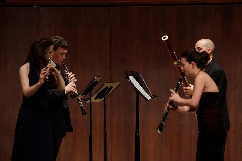 Jeffrey Reinhardt on Oboe, Emi Ferguson on Flute, Moran Katz on Clarinet and Adrian Morejon on Bassoon perform at  Paul Recital Hall, Juilliard School during  Juilliard's 40th Anniversary Concert  on October 8, 2009 in New York City. photo by Joe Kohen for The New York Times