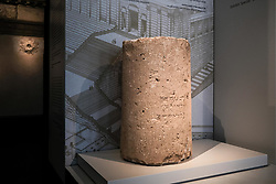 "October 9, 2018 - Jerusalem, Israel - A 2,000 year old stone column drum, Second Temple Period (First Century CE), around the time of Herod the Great's reign, unearthed earlier in 2018 in excavations underway near Binyanei HaUma, Jerusalem's International Convention Center, bears an engraved Aramic inscription reading ""Hananiah son of Dudolos from Jerusalem"". Archaeologists share their excitement during a joint press conference of the Israel Antiquities Authority and the Israel Museum stressing this is the first and only Second Temple era artifact which displays the full spelling of Jerusalem, written in Hebrew letters, 'Yerushalayim', as it is spelled today. The archaeological context of the inscription does not allow determination who Hananiah son of Dudolos was, but it is likely that he was an artist potter, the son of an artist potter, who adopted a name from the Greek mythological realm, following Daedalus, the infamous artist. (Credit Image: © Nir Alon/ZUMA Wire)"