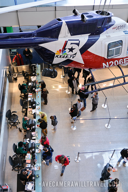 A news helicopter is suspended above the entrance hall of the Newseum, right above the ticket counter. The Newseum is a 7-story, privately funded museum dedicated to journalism and news. It opened at its current location on Pennsylvania Avenue in April 2008.