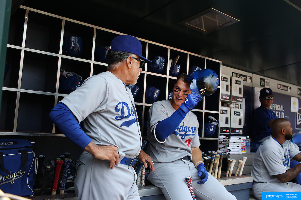 Joc Pederson, Los Angeles Dodgers, with coach Davey Lopes in the dugout during the New York Mets Vs Los Angeles Dodgers MLB regular season baseball game at Citi Field, Queens, New York. USA. 26th July 2015. Photo Tim Clayton